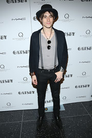 Reeve Carney chose a navy jacket to pair over his V-nck and suspenders for a cool hipster look at the pre-Met ball screening of 'The Great Gatsby.'