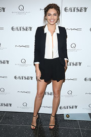 Alyssa Miller kept her evening look chic and simple with a black blazer paired over a crisp white button up.