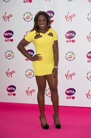 For a totally sexy finish, Sloane Stephens paired multi-textured sky-high black platform pumps with her tiny dress.