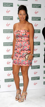 Ana Ivanovic complemented her modern dress with a pair of strappy silver Christian Louboutin sandals.