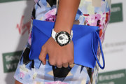 Holly Branson carried a satin envelope wristlet at the Pre-Wimbledon Party.