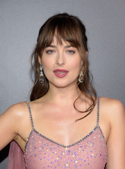 Dakota Johnson sported a casual half-up hairstyle at the premiere of 'Bad Times at the El Royale.'