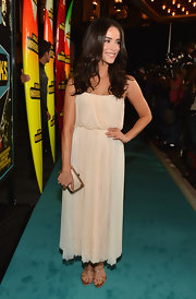 Abigail Spencer paired strappy gold heels with her ethereal ivory dress.