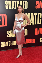 Amber Stevens West shimmered in a sexy silver Fame and Partners cocktail dress at the premiere of 'Snatched.'