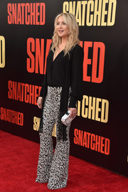Kate Hudson rounded out her look with a marbled clutch by Edie Parker.
