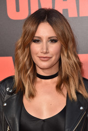 Ashley Tisdale attended the premiere of 'Snatched' wearing a subtly wavy, center-parted 'do.