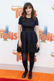 Zooey Deschanel channeled her inner little girl in this navy and black baby doll dress for the premiere of 'Trolls.'