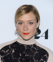 Chloe Sevigny made her lips look fuller and more supple with a bright orange lipstick.