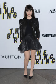 Felicity Jones rocked an all-black look with a floral-embossed leather skirt.