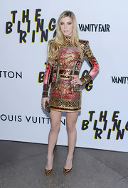 Claire Julien rocked a more edgy look at the 'The Bling Ring' premiere when she sported this long-sleeve fully embellished frock.