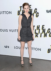 Emma Watson chose this tweed frock that featured a tiered skirt and a high collar for her look at the premiere of 'The Bling Ring.'