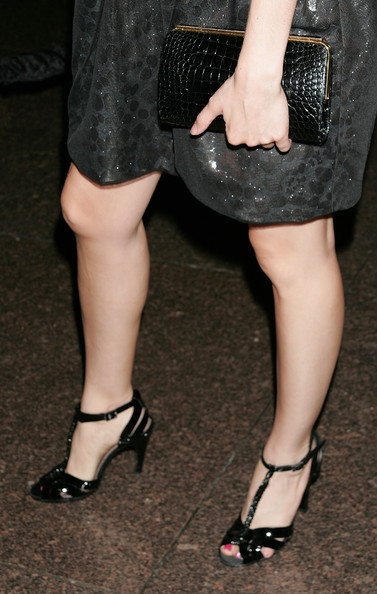 Alison Brie carried an elegant black crocodile frame clutch when she attended the premiere of 'Mad Men.'