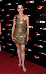 Janie shined on the red carpet in a metallic, asymmetrical cocktail dress with an embellished shoulder.