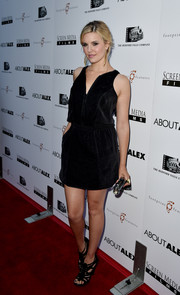 Maggie Grace styled her simple LBD with sexy black gladiator heels.