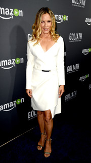 Maria Bello looked sharp in a white wrap dress with an asymmetrical hem at the premiere of 'Goliath.'