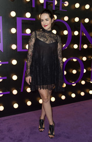 Jena Malone paired her cute dress with black ruffle sandals by Olgana Paris.