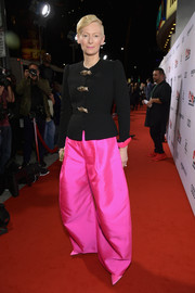 Tilda Swinton went funky on the bottom half in a pair of baggy hot-pink trousers, also by Schiaparelli Couture.
