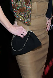 Cherie paired her suede corset dress with an elegant clutch.
