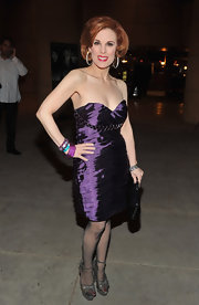 Katherine Kramer wore a hot purple iridescent dress for the 'Beneath the Darkness' premiere.