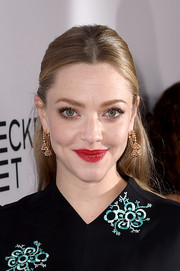 Amanda Seyfried opted for a demure half-up style when she attended the premiere of 'The Last Word.'
