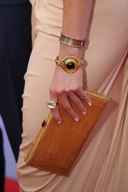 Jennifer accessorized her Donna Karan dress with these Victorian gold and garnet bracelets