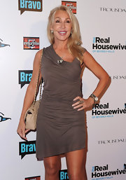 Linda Thompson wowed in a gathered gray dress with an asymmetrical neckline.
