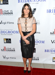 Nikki Reed was equal parts ladylike and edgy in a Catherine Deane dress with a nude lace bodice and a black leather skirt during the 'Bridegroom' premiere.