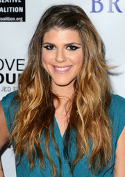 Molly Tarlov wore her hair down in a cascade of waves when she attended the 'Bridegroom' premiere.
