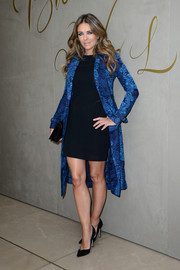 Elizabeth Hurley elevated a simple LBD with a printed blue trenchcoat when she attended the Burberry festive film premiere.