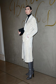 Erin O'Connor looked sharp in a white suede jacket and gray boots at the Burberry festive film premiere.