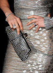 Jenifer Lopez matched her stunning silver one-shouldered dress to a studded buckle clutch. Her gorgeous clutch was a great way to add some edge to her look.