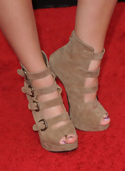 "Taylor wore these killer ankle strap boots to ""The Back Up Plan"" premiere. They were in a great tan color that will spice up any spring ensemble."
