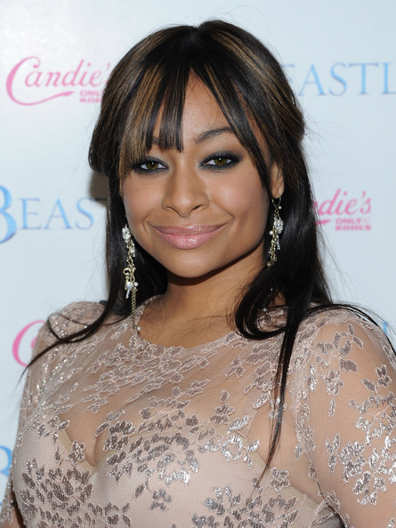 Raven-Symonre added chain embellished earrings to her lace clad dress.