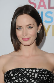 Emily Blunt attended the premiere of 'Salmon Fishing in the Yemen' wearing a pair of diamond cluster earrings set in platinum.