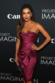 Eva Longoria was all dolled up in a wine-colored strapless dress with peplum detailing during Canon's Project Imaginat10n Film Festival.