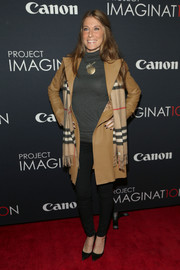 Samantha Nagel layered a camel-colored leather coat over a gray turtleneck for a retro look during Canon's Project Imaginat10n Film Festival.
