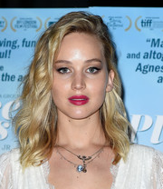 Jennifer Lawrence added a bold pop of color with some berry lipstick.