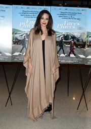 Angelina Jolie bundled up in a floor-sweeping caftan cape for the premiere of 'Faces Places.'