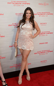Sophie Simmons opted for a pair of cuffed platform sandals to match her cute dress.