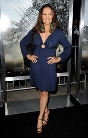 Tia wears a navy knit cocktail dress with long sleeves and an eye-catching key hole at the premiere of 'Battle: LA.'
