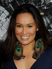 Tia Carrere wore peacock feather earrings at the premiere of 'Battle: Los Angles.'