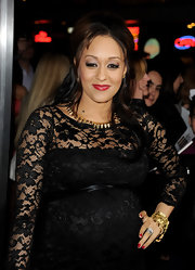 Tia Mowry paired her lace clad dress with a gilded link necklace.