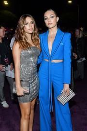 Maddie Ziegler teamed a studded silver box clutch with an electric-blue pantsuit for the premiere of 'Charlie's Angels.'