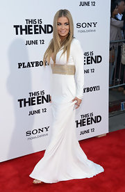 Carmen Electra chose a crisp white long-sleeve gown that featured a gold and silver embellished waist for her red carpet look.