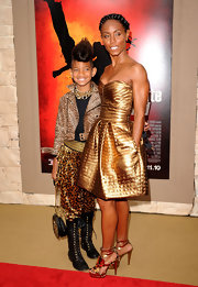Jada paired her metallic leather cocktail dress with eye-catching geometric metallic sandals.