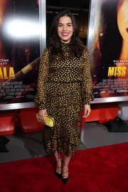 A yellow velvet clutch by Tyler Ellis completed America Ferrera's ensemble.