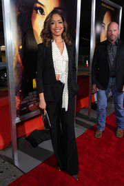 Gina Torres looked cool in a black pantsuit teamed with a dotted white crop-top at the premiere of 'Miss Bala.'
