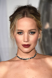 Jennifer Lawrence rocked a messy-sexy center-parted updo at the premiere of 'Passengers.'