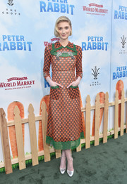 Elizabeth Debicki went for a retro-chic logo-embroidered midi dress by Gucci when she attended the premiere of 'Peter Rabbit.'