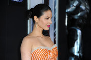 Olivia Munn pulled her hair back into a bun for a classic feel during the 'Robocop' premiere.